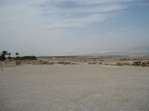 The Jordan enters the Dead Sea to the left, where the dense growth of trees and plants are visible. The baptism site is about four miles upriver.